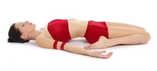 Yoga postures supta virasana (reclining hero position)