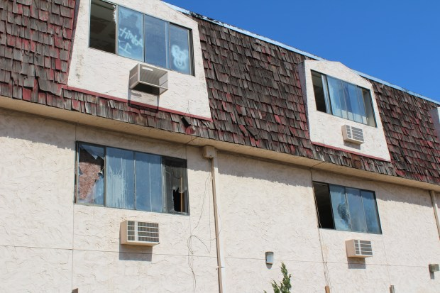 Windows have been broken out at the abandoned hotel on Sutter Street. (Jake Hutchison - Daily News)