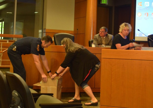 Julie Zeeb - Daily NewsRandy Rapp accepts a donation of pulse oximeters purchased through the Ronnie Lee King Memorial Ride from Ronnie Lee's grandmother Jeannie Garton on Tuesday at the Tehama County Board of Supervisors meeting.