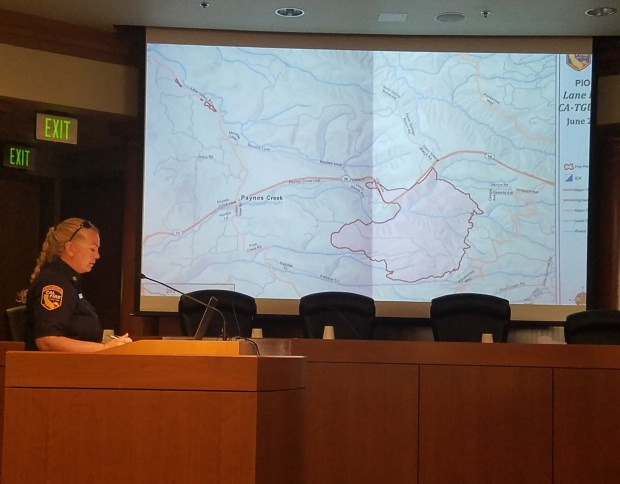 Julie Zeeb - Daily NewsCalFire Chief Christine Thompson talks about the Lane Fire, pictured in a map, Tuesday at the Tehama County Board of Supervisors meeting.