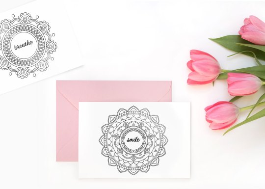 Photo of a mandala coloring page insert next to an envelope
