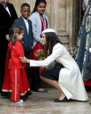 Meghan Markle greets a child as she departs from the 2018 Commonwealth Day service at Westminster Abbey on March 12, 2018 in London, England.