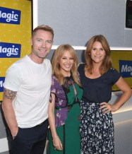 Kylie Minogue poses with Ronan Keating and Harriet Scott during a visit to Magic Radio