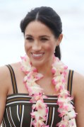 Meghan, Duchess of Sussex talks to members of OneWave, an awareness group for mental health and wellbeing at South Bondi Beach