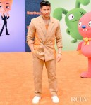 Nick Jonas Rocks A Tan Suit For The 'UglyDolls' LA Premiere
