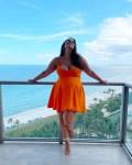 Ashley Graham Wore An Orange Versace Maternity Mini