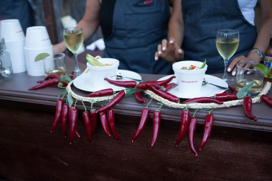 Display of red peppers at a Chili Cookoff that elevates decor and creativity.