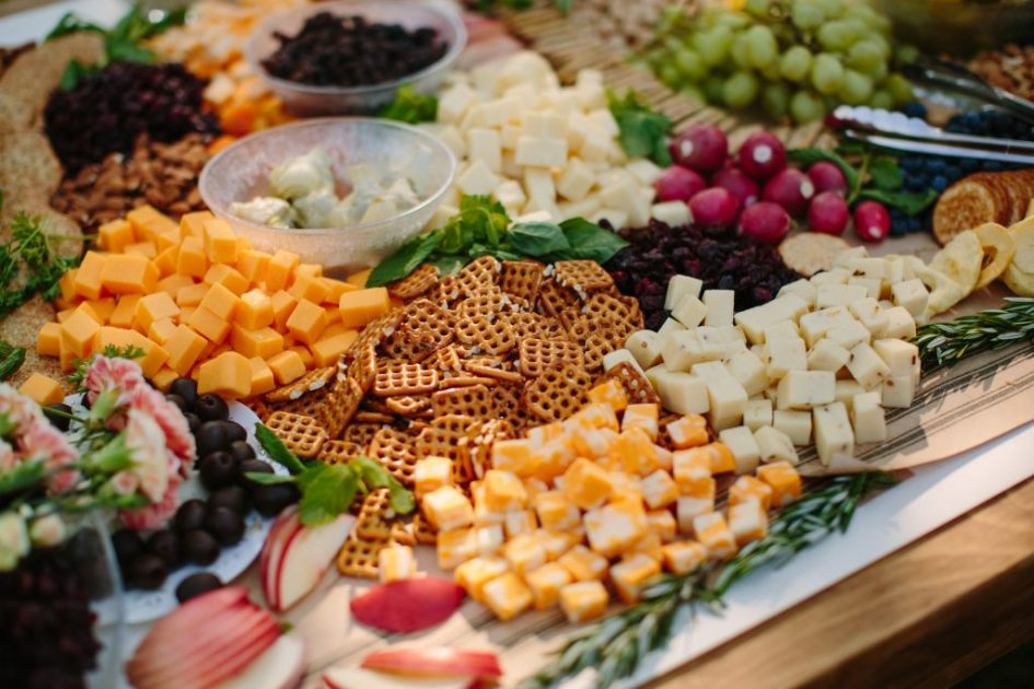 display of cheeses and fruit