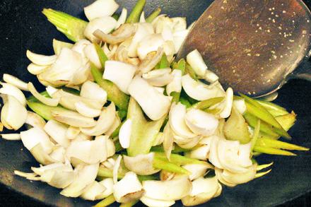 Stir-fry Lily Bulbs and Celery in a Wok