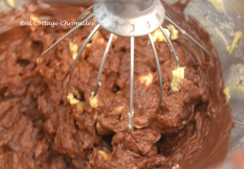 Beat in the melted chocolate mixture until smooth.