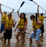 Children with oars in the water at a Canadian Red Cross Water Safety Day Camp