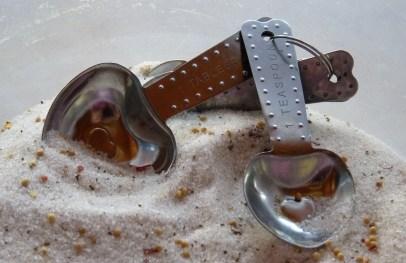 spoons in pickle mixture
