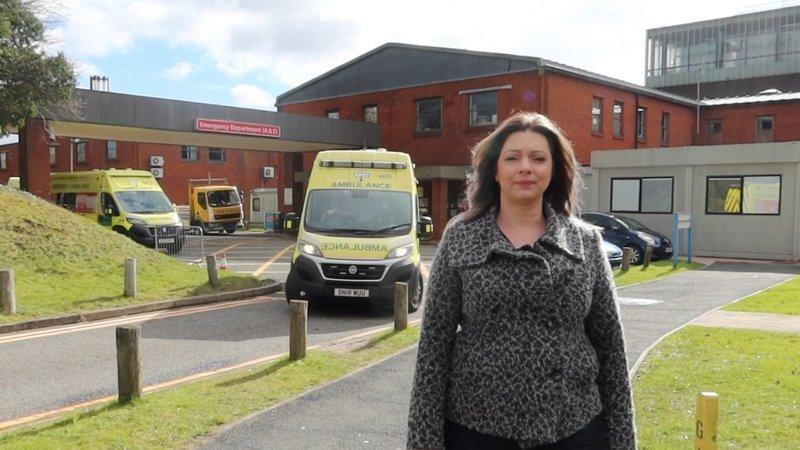 Emma outside Alex Hospital