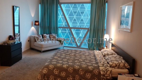 Large hotel style bedroom with white grey and baby blue