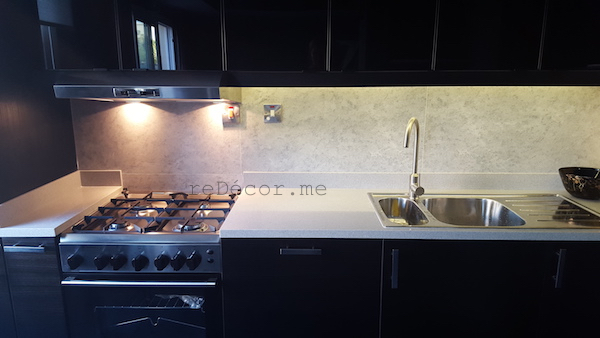 manly kitchen, corian grey Eclipse work top, ceramic tile, blac beauty, ceramic tile, black kitchen remodelling, Springs dubai, grey work top, built in range hood , design consultation
