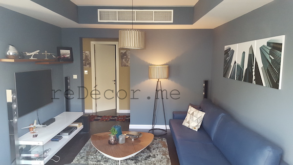 smart, sharp blue living room with wooden dar flooring, Interior design dubai