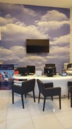 travel shop design, decor, dubai, interiors, fitout , turn key, perswall clouds, map wallpaper, dnata