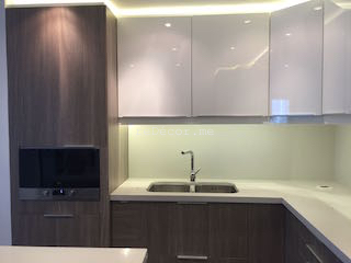 kitchen remodelling fitout dubai, modern kitchen executive towers, business bay kitchen, stone counters, island kitchen, corner storage, built in washing machine, teka basin, built in microwave