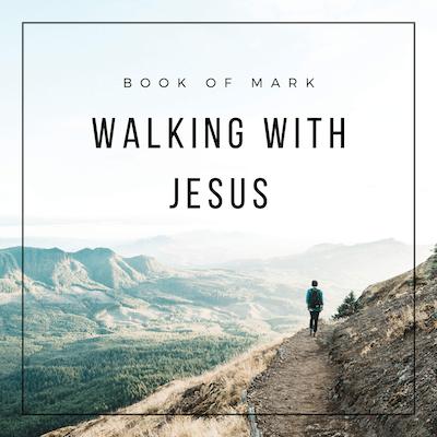 Man walking across scenic mountain range