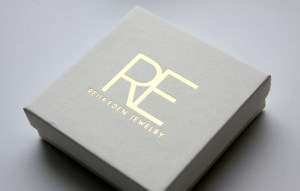 gold and white jewelry packaging by Reija Eden Jewelry
