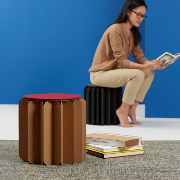 Bookniture in use Bookniture – hide this chair on your bookshelves