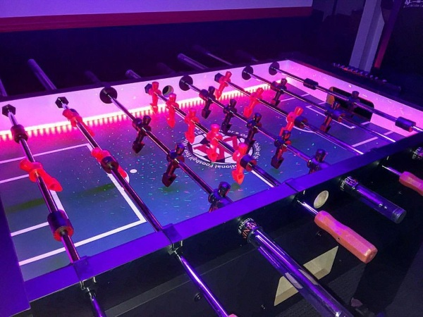 Warrior Professional Foosball Table – play foosball in the dark with this LED equipped table