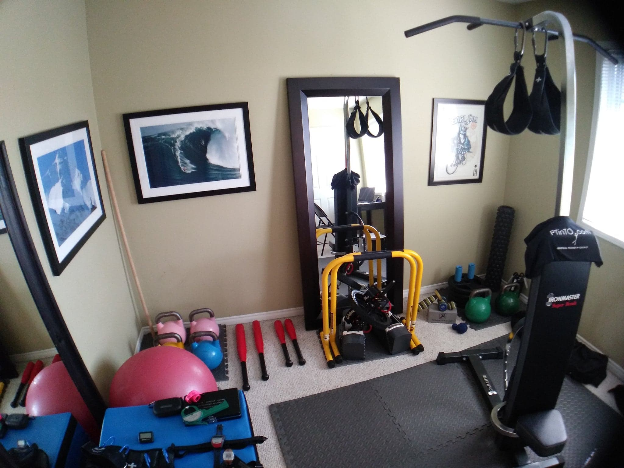 treadmill and workout equipment in room