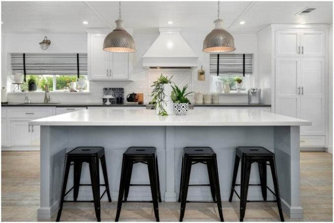 bright white kitchen with bar stools