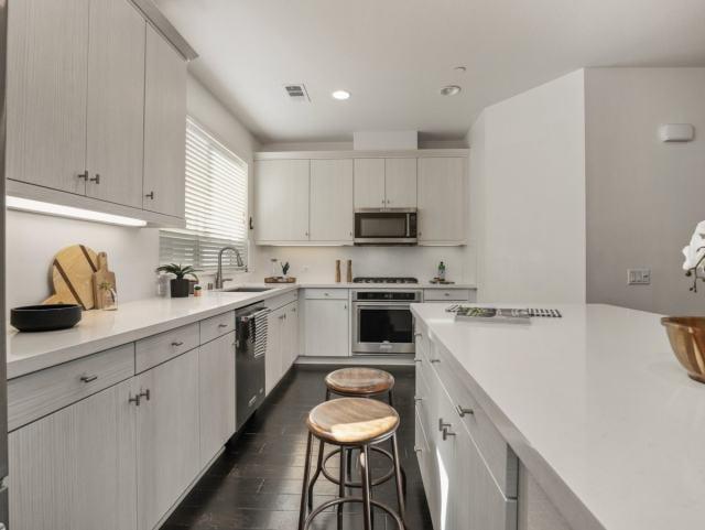 updated white kitchen stainless steel appliances