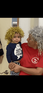 Mother and baby wearing crazy wigs.
