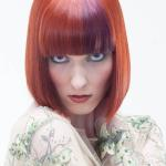 Bob hair cut with copper hair color and burgundy color blocking