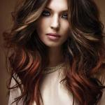 Long layered brown hairstyle with mahogany copper highlights