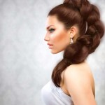 Thick dark auburn hairstyle with high ornate braid