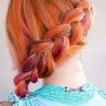 Tangerine strawberry hair color braided hairstyle