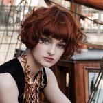 Short wavy auburn hairstyle with bangs