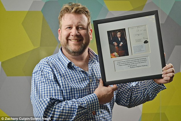 Simon Rhodes with framed photo