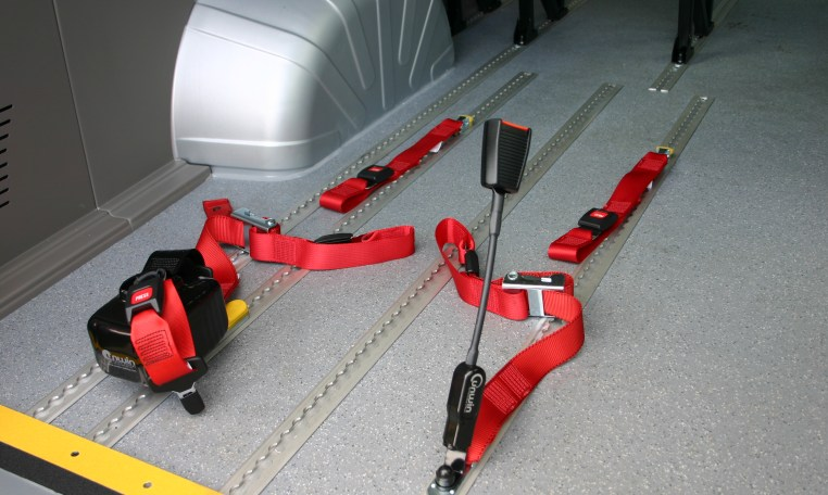 Belt system to secure wheelchair and passenger