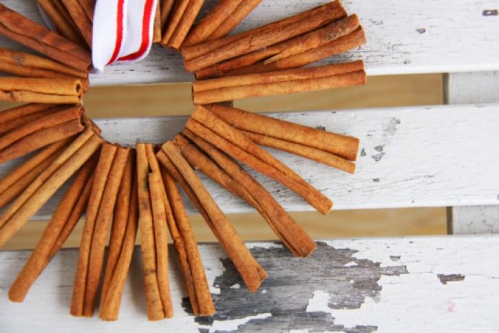 Homemade Christmas ornaments using cinnamon sticks.