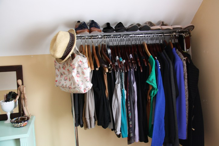 Clothes rack with wooden hangers.