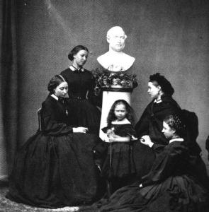 Victoria and her daughters at the bust of Albert