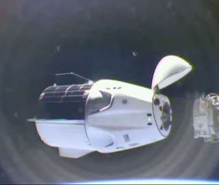 International Space Station Crew Moves SpaceX Crew Dragon to Another Port