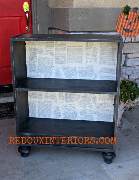 Bookshelf backed with bookpages redouxinteriors