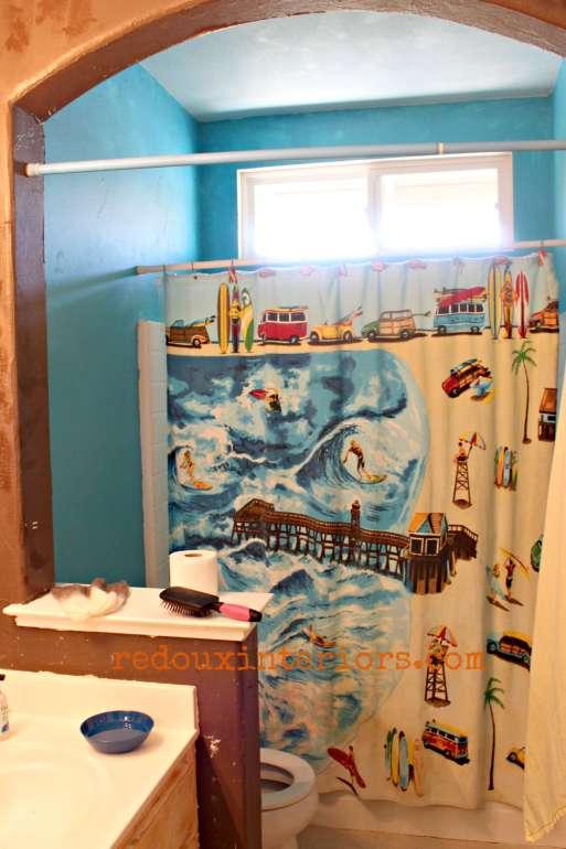 ugly beach themed bathroom redouxinteriors