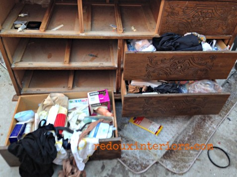 Dresser in Dumpster container with drawers full redouxinteriors