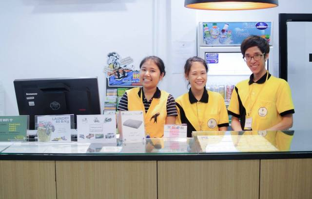 D-Well-Hostel-staff-behind-reception-desk