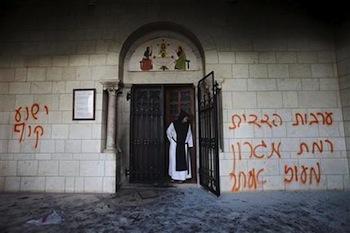 """Jewish settlers daub """"Jesus is a monkey"""" on church in Jerusalem"""