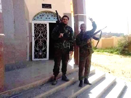 Libyan army soldiers stand at the entrance of Sheherazade Hall, Old Leithi, east Benghazi, just after its liberation from jihadist cutthroats