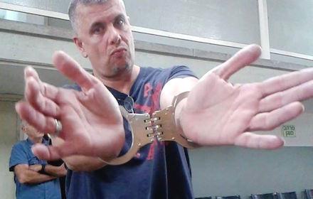 Israeli whistleblower Rafi Rotem in handcuffs