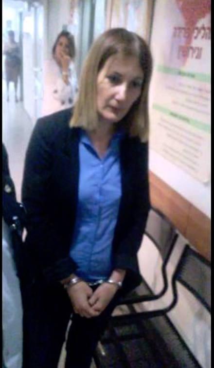 Lory Shem Tov handcuffed in police custody