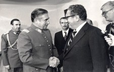 Henry Kissinger and Augusto Pinochet shaking hands